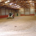Indoor riding arena graded and rolled